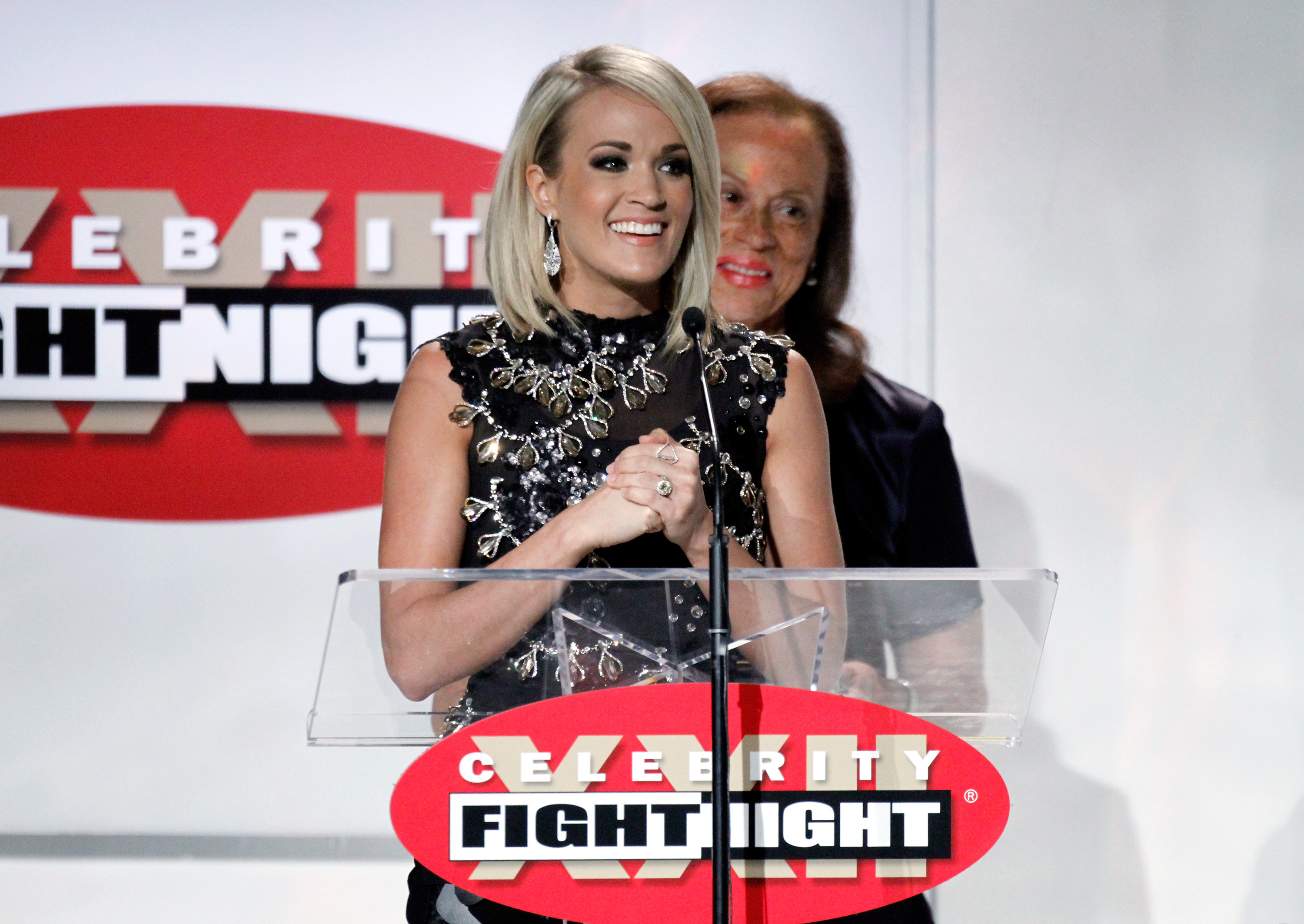 Carrie receiving The Muhammad Ali Celebrity Fight Night Award
